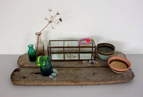 Glass and brass display box, Nadia Dafri bracelets, Charlotte Jones bowls and recycled glass bottles. (PRNewsFoto/Rocke _ Nutter)