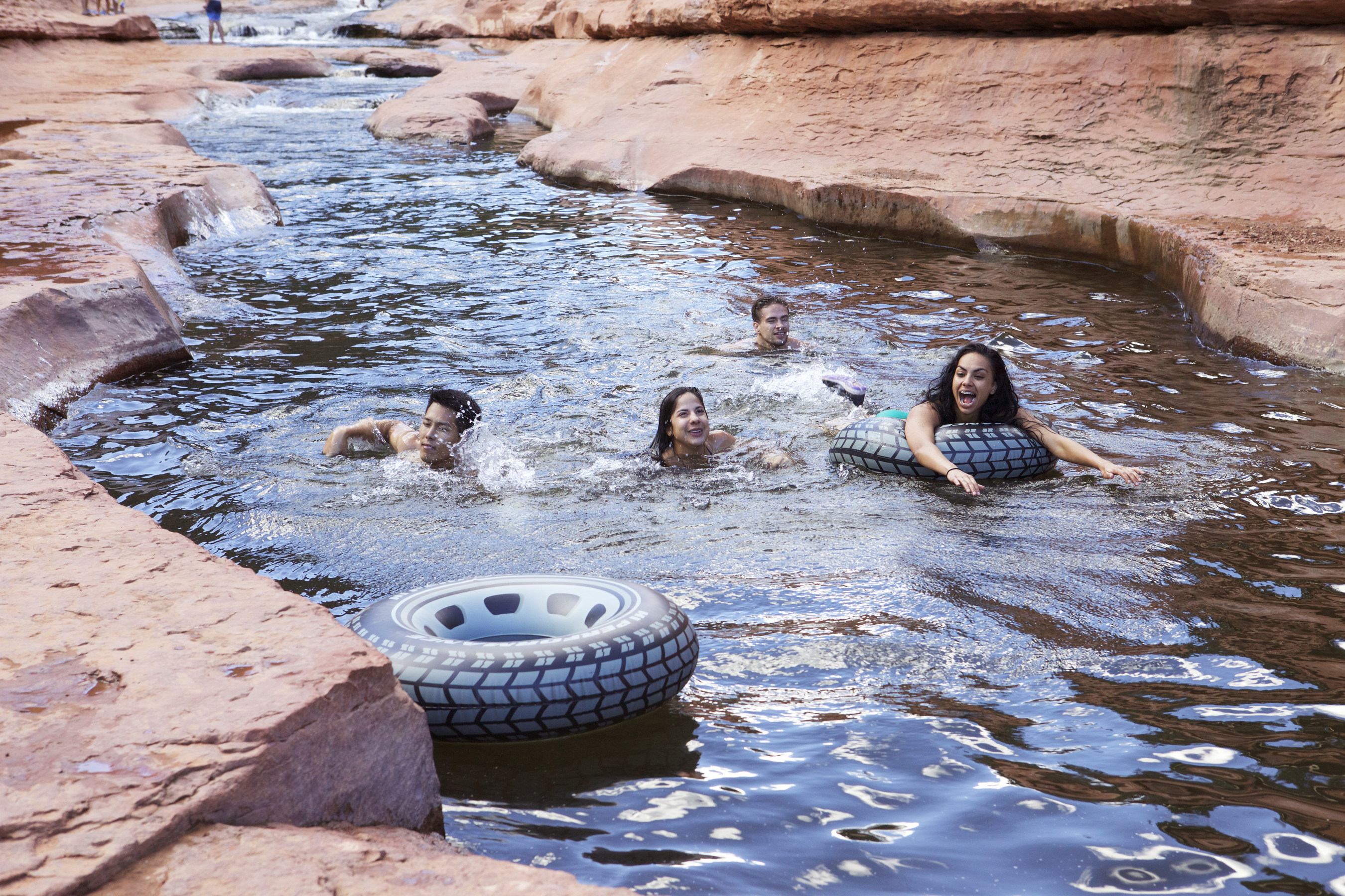SlideRock AZ - Swimmers float along Arizona's Slide