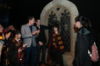 James and Oliver Phelps sort a fan into his Hogwarts house at the opening of Harry Potter: The Exhibition in Shanghai, China.
