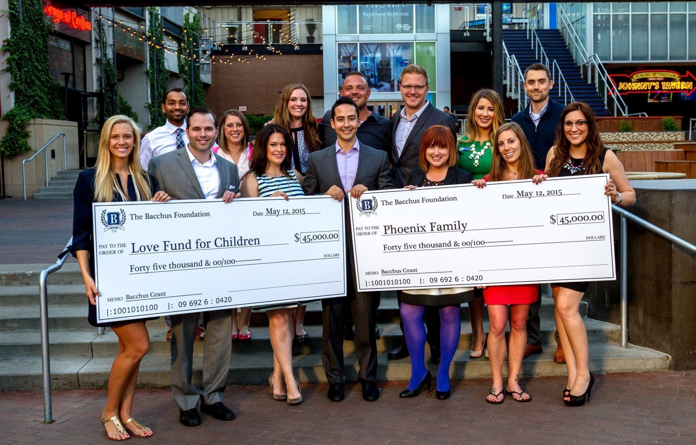 Bacchus Foundation Board of Directors presenting checks to their beneficiaries.