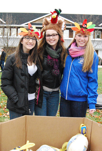 Students volunteer at the Gill St. Bernard's School annual Turkey Day event to benefit the Community Food ...