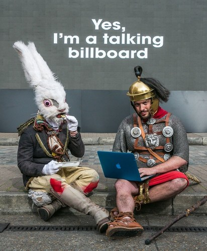 A rabbit and Roman centurion take a break whilst filming for giffgaff's stunt at the Old Truman Brewery, Brick Lane. The stunt was created by giffgaff - the community-led mobile network most known for its no-contract approach to mobile - to highlight their recent TV ad that encapsulates what it means to be free from restrictive contracts. (PRNewsFoto/giffgaff)