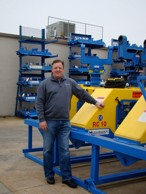 Vacuworx President Bill Solomon and a stockpile of RC 10 Series lifters housed near the company's home office in Tulsa, Oklahoma.