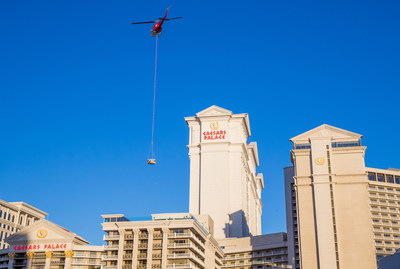 A helicopter delivers a Japanese-inspired onsen tub to the rooftop sky deck of the Nobu Villa at Nobu Hotel Caesars Palace Las Vegas. The 10,300 square feet Nobu Villa is set to debut later this summer and marks the completion of the world's first Nobu Hotel. Photo Credit: Erik Kabik/ Retna