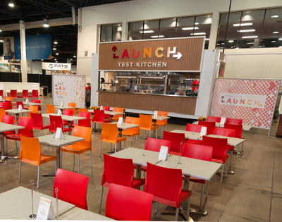 Aramark's new Launch Test Kitchen is an industry-leading, forward-thinking approach to dining at sports and entertainment venues that invites real-time feedback submissions from guests, and uses it to shape what's offered on the menu. Pictured, the Launch Test Kitchen pop-up, mobile restaurant at the Las Vegas Convention Center.