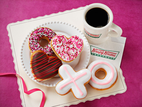 This Valentine's Day, be sweet to someone special with a box full of hugs and kisses, and heart-shaped deliciousness from Krispy Kreme.  Krispy Kreme(R) Sprinkled Heart, Valentine Sprinkles, Chocolate Iced Heart, and new Hugs and Kisses doughnuts are available January 27 through February 14th at participating Krispy Kreme(R) US and Canadian locations.  (PRNewsFoto/Krispy Kreme Doughnut Corporation)