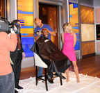 Mark Herzlich Shaves Pierre Garcon's Head as Victor in Wahl Head-to-Head Challenge.  (PRNewsFoto/Wahl Clipper Corporation)
