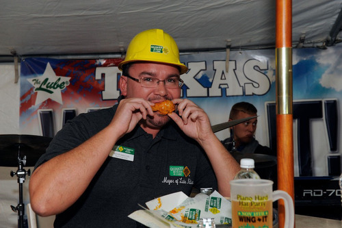 Mayor of Lube Nation, Ken Rumbaugh, making history eating Quaker Steak & Lube's billionth wing!  (PRNewsFoto/Quaker Steak & Lube)