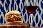 Southern fried chicken sandwich topped with kimchi cabbage slaw paired with Nero d'Avola. Look for Sicilia DOC on the label at local grocery and beverage shops.
