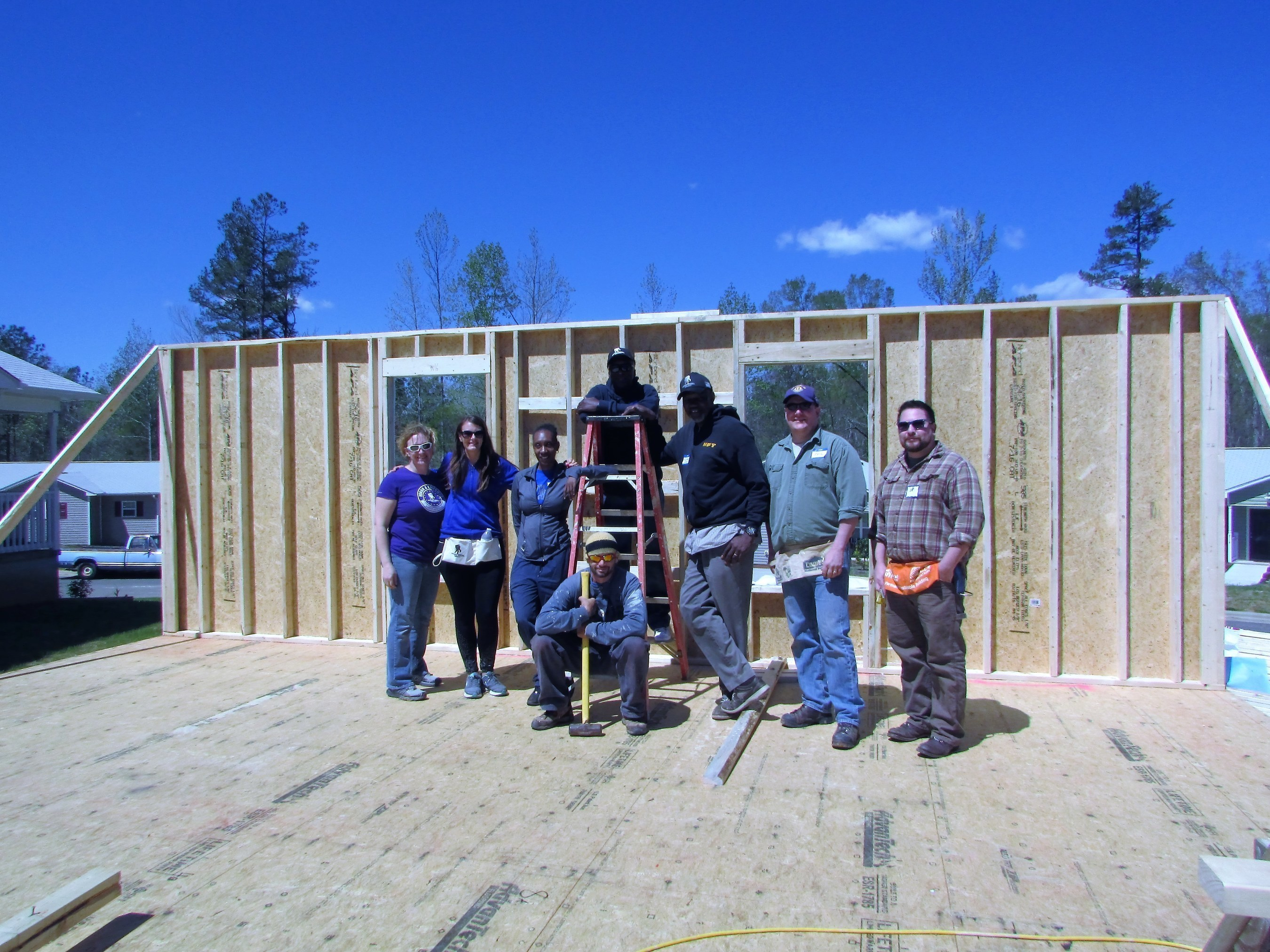 Wounded veterans build a wall during service project.