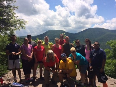 The group of veterans pose for a picture atop a mountain in the Catskills. Photo courtesy of Adaptive Sports Foundation.