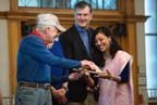Former President Jimmy Carter passes a symbolic wooden trowel to Habitat for Humanity Nepal representative Sushma Shrestha. (PRNewsFoto/Habitat for Humanity)