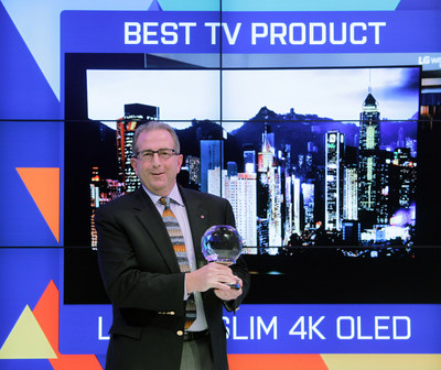 Tim Alessi, Director of New Product Development for LG Electronics USA, accepts the Engadget Best of CES 2015 Award for Best TV Product for LG's 65EF9500 Art Slim 4K OLED TV at the 2015 INTERNATIONAL CES(R).