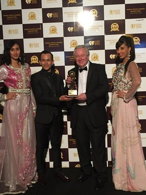 WTA Founder and President Graham Cooke hands over the trophy for the Worlds Leading Integrated Tourism Group