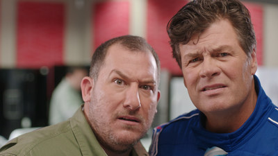 "Michael Waltrip and an Aaron's customer give the camera a quizzical look in the lighthearted Aaron's TV commercial, ""Race Talk."" The commercial will premiere during the DAYTONA 500 on FOX as part of a new media campaign and multi-year partnership agreement between Aaron's, Inc. (AAN) and Michael Waltrip."
