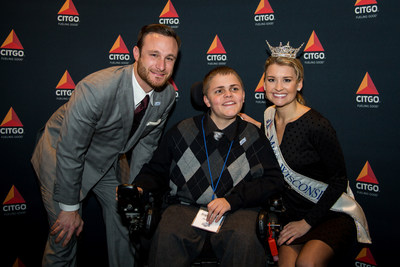 Jonathan Lucroy of the Milwaukee Brewers, Angelo Ortiz and Miss Wisconsin Raeanna Johnson pose for a photo at the MDA Muscle Team Event in Milwaukee on Nov. 13.