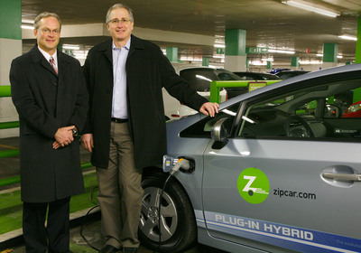 (left to right) Frank Miller, Regional Distribution Manager, Toyota Motor Sales, and Scott Griffith, Chairman and CEO of Zipcar, stand in front of one of the new Toyota Prius PHVs to enter the Zipcar Fleet in Cambridge, Mass.  (PRNewsFoto/Zipcar)