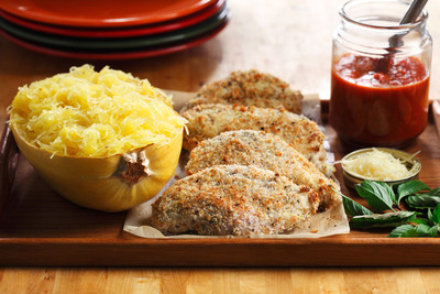 """The trick to a crisp but healthy parmigiana is """"bake-frying."""" Canola oil is ideal to bake-fry breaded chicken with in a very hot oven because of its high heat tolerance (smoke point 468°F). Using spaghetti squash instead of angel hair pasta provides four times fewer calories per cup (174 versus 42 calories)."""