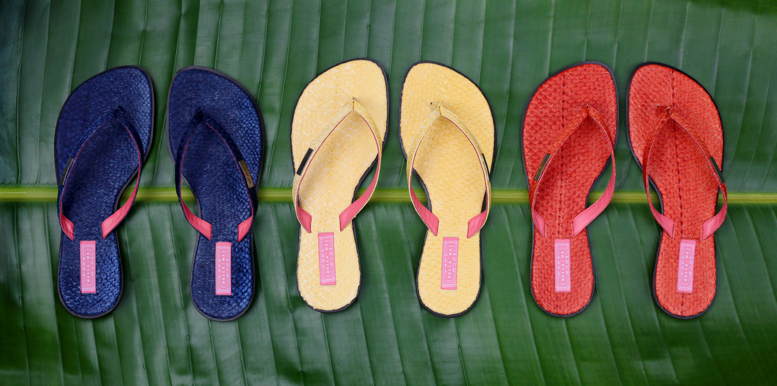 Three of the six different colors of Bella   Ha Khanh Hoa collection shoes. The tags on each shoe give the longitude and latitude of the Khanh Hoa province in Vietnam, where the first Solar Suitcase was donated.