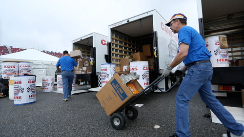Aaron's, Inc. hosted a can drive over race weekend at Talladega Superspeedway that collected three tons of food for the Community Food Bank of Central Alabama.  (PRNewsFoto/Aaron's, Inc.)