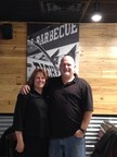 Stephanie and Preston Reeves inside their new Dickey's Barbecue Pit. The couple celebrates a three day grand opening starting Thursday.