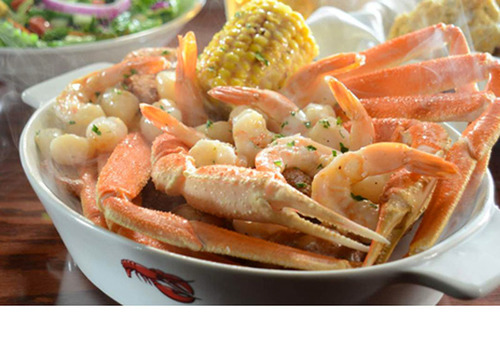 Crab & Roasted Garlic Seafood Bake Steamed snow crab legs paired with tender shrimp and bay scallops roasted in  ...