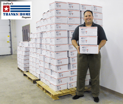 """UniFirst Senior Vice President Mike Croatti created a """"Thanks from Home"""" program to thank soldiers who are serving in the Middle East for their many sacrifices. This year's second annual program sent 300 """"care packages"""" to U.S. Army and Marine Corps soldiers serving in Afghanistan.  (PRNewsFoto/UniFirst)"""