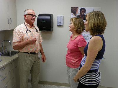Baldwin Filters employees visit with a health care provider at the open house celebrating the opening of an onsite wellness center at the company's headquarters in Kearney, NE.  (PRNewsFoto/Baldwin Filters)