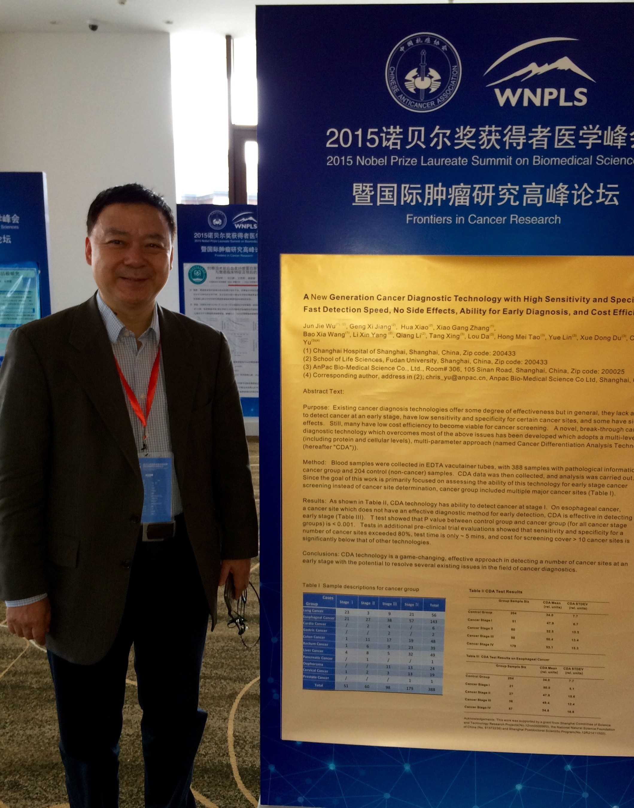 """At an unprecedented meeting of five Nobel Prize Laureate winners and the 20 acknowledged top cancer researchers worldwide, the """"2015 Nobel Prize Laureate Summit on Biomedical Science: Frontiers in Cancer Research,"""" (NPLS) in Tianjin, China, featured what organizers listed as """"game changing"""" research presented by Dr. Chris Yu, CEO of Anpac Bio-Medical Company (pictured here before am Anpac CDA display). Anpac's """"Cancer Differentiation Analysis"""" (CDA) technology creates non-invasive, """"Blood Biopsies"""" ..."""