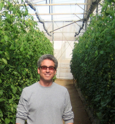 Dan Gibbs, CEO Home Town Farms, standing in between a row of vertical growing systems.  (PRNewsFoto/Home Town Farms)