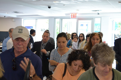 Pictured: Crowds wait to open accounts at Community National Bank's newest office in Hewlett, NY on Sunday 9/29.  (PRNewsFoto/Community National Bank)