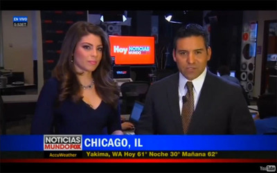 Pictured: Rolando Nichols, anchor for Noticias MundoFox Network, and Nicole Suarez, anchor for Hoy Noticias MundoFox 13, co-hosting the national news from the Hoy newsroom in Chicago.  (PRNewsFoto/Hoy)