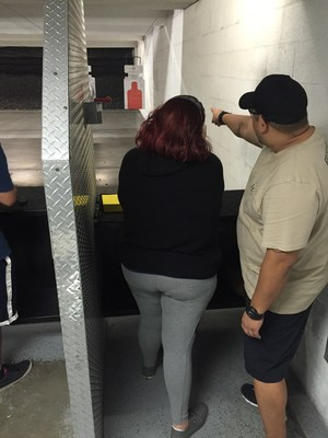 Wounded Warrior Project takes injured veterans and their spouses to an indoor range to learn about importance of gun safety