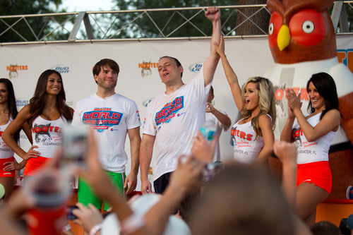 Joey Chestnut wins Hooters World Wing Eating Championship in Clearwater, FL after eating 144 wings in 10 minutes.  (PRNewsFoto/Hooters of America, LLC)