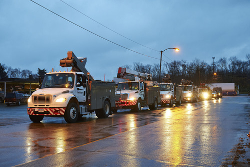 Line crews and support personnel from FirstEnergy's Ohio Edison, The Illuminating Company, and Toledo Edison utilities left Ohio early this morning from dozens of locations heading to New Jersey in advance of Hurricane Sandy to assist sister utility JCP&L.  Five bucket trucks and other support vehicles are shown here leaving from an Ohio Edison garage in Akron, Ohio.  The severe weather is expected to result in power outages that could last from seven to 10 days in New Jersey.  Overall, more than 200 linemen and 1,000 support personnel ...