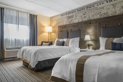One of the 85 beautifully decorated guest rooms at the enVision Hotel St. Paul South, an Ascend Hotel Collection member.