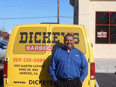 Owner/Operator Albert Barreno opens Dickey's Barbecue Pit in Merced on Thursday.