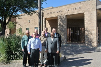 ICoE to Work with AITC. AITC team: Mark Ulatowski, Ron Timmer and Alfonso Bodden. ICoE team: James Beyer, James Cox, Robert Guivens and William Todd. The group is in front of the Kelly Operations Building, part of the Intelligence Center and School.  It is named in honor of Colonel Robert Kelly, a career intelligence officer who died in a helicopter crash in 1993.  He was inducted into the Intelligence Hall of fame in 1996 the same year the building was named in his honor.