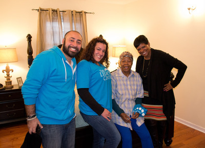 (L to R) The Legacy Center's Executive Director Jordan Durso and Operations Director Diana Denis, with homeowner Betty Robinson and K.I.D.S. President Denise Durham Williams, in Betty's newly renovated and furnished bedroom. (PRNewsFoto/Kids In Distressed Situations (K.I.D.S.)) (PRNewsFoto/K.I.D.S.)