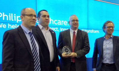 Jeroen Tas (far right) CEO of Philips Healthcare Informatics Solutions and Services Business joins Yahir Briman (far left) and Erwin Thomas (center) in accepting KLAS Award for IntelliSpace Portal as Category Leader in Enterprise Advanced Visualization Software. Presenting the award is Ben Brown (left center) from KLAS.