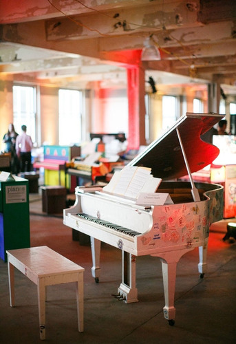 Team members from Chobani designed a piano as part of Sing for Hope Pianos.  Both Sing for Hope and Chobani ...
