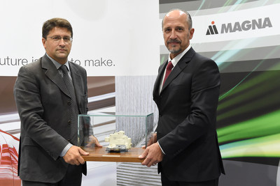 Riccardo Berti (left), Director of Product Management & Business Development at Magna Closures Europe, and Franco Ottino, Director of Engineering at Magna Closures Europe, at the 50 million latches celebration held at Magna's Guasticce, Italy, manufacturing facility. (PRNewsFoto/Magna International Inc.)