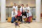 The Washington State University College of Veterinary Medicine Pituitary Team poses for a photo with Boxer Anna, her guardian Sundays Hunt and American Dog Rescue Founder Arthur E. Benjamin  Front Row: Anna (First TSH patient at WSU) Second Row (From left to right): Tina Owen, Arthur Benjamin, Sundays Hunt, Abby Thomson (4th year veterinary student) Third Row (From left to right): Tom Jukier (Neurology intern), Annie Chen-Allen, Linda Martin, Megan Bauer (4th year veterinary student)