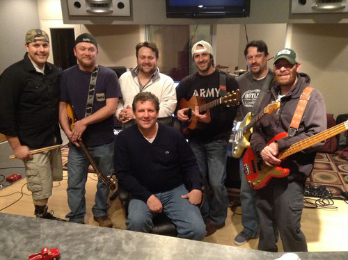 VAP Operation Artists in Action - Outlaw 21 Band at IMI Recording Studio in Franklin Tennessee - Names from L to R - Dale Beatty, Outlaw 21 Band Leader, Steve Sharpe, VAP founder BR McDonald, Lead singer Eric Hartness, Brian Gaither, Tommy Beaver, Seated IMI producer Steve Ivey. (PRNewsFoto/Veteran Artist Program)