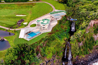 Set on a breathtaking cliff along the Hamakua Coast, this former macadamia nut plantation has been transformed into a jaw-dropping, 9.44-acre estate with five bedrooms, ten bathrooms, unparalleled amenities and never-ending views of the Pacific. The property includes a helipad, 9-tee golf course, paved running track, Olympic infinity pool, and 450-seat tennis stadium and basketball court.