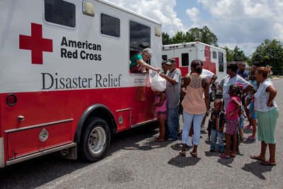 Red Cross workers distribute hot meals in Eunice, St. Landry Parish, Louisiana. Red Cross photo by Marko Kokic