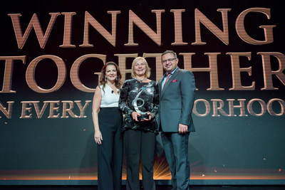 Applebee's executives honor Bonnie Lippincott on stage as The 2016 Operator of the Year Award winner in Beverly Hills on Sept. 29, pictured left to right: Julia Stewart, President, Applebee's; Bonnie Lippincott, Chief Operating Officer, The Rose Group; Sanjiv Razdan, SVP of Operations, Applebee's.