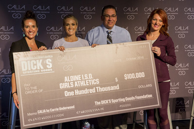 CALIA by Carrie Underwood in partnership with The DICK'S Sporting Goods Foundation's Sports Matter program surprises unsuspecting athletes and coaches of the Aldine Independent School District with a $100,000 check donation at the DICK'S Sporting Goods Grand Opening Celebration at Baybrook Mall in Friendswood, TX on October 21, 2016. (Photo by Scott Dalton/Invision for DICK'S Sporting Goods/AP Images)