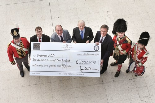 L-R: James Deeny, Managing Director of The London Mint Office, Phill McDermott, Chairman Worcestershire Medal Service, Major General Sir Evelyn Webb-Carter Co-Chairman Waterloo 200 and Timothy Cooke Co-Chairman Waterloo 200 joined by Battle of Waterloo re-enactment actors (PRNewsFoto/The London Mint Office) (PRNewsFoto/The London Mint Office)