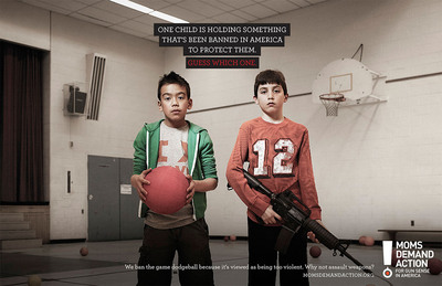 One child is holding something that's been banned in America to protect them. Guess which one.  (PRNewsFoto/Moms Demand Action for Gun Sense in America)